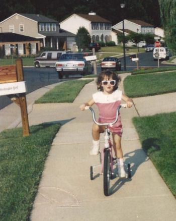 Me on a bike at 3 yrs.